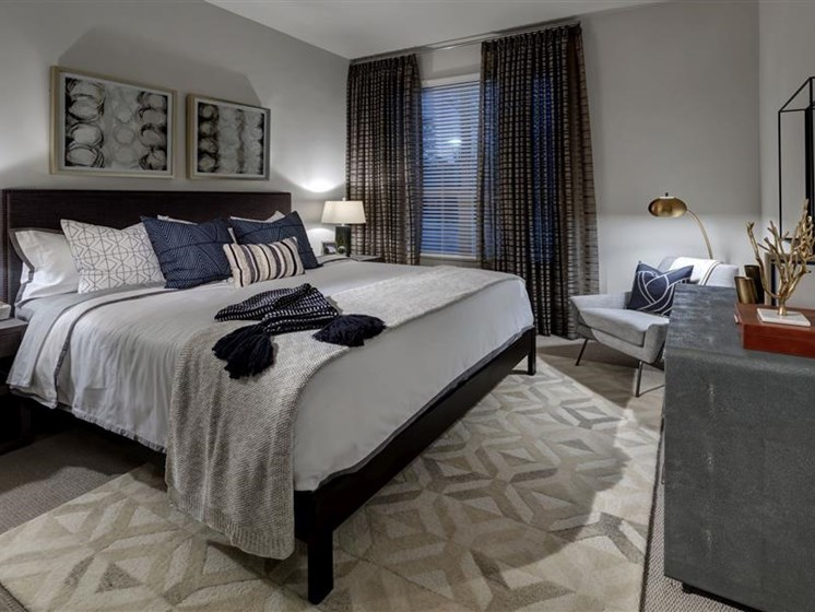 Master bedroom with luxurious carpeting
