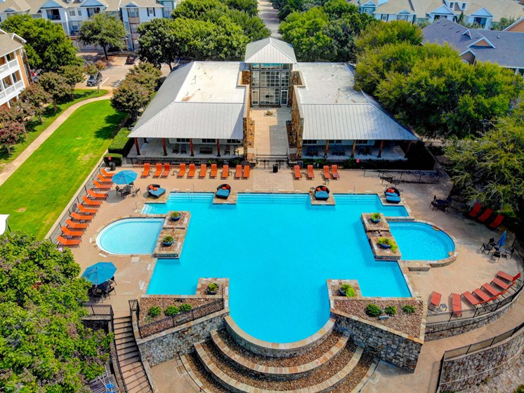 Apartments in The Colony TX-Flatiron District at Austin Ranch Swimming Pool with Two Hot Tubs, Shaded Seating, and Lounge Chair Seating