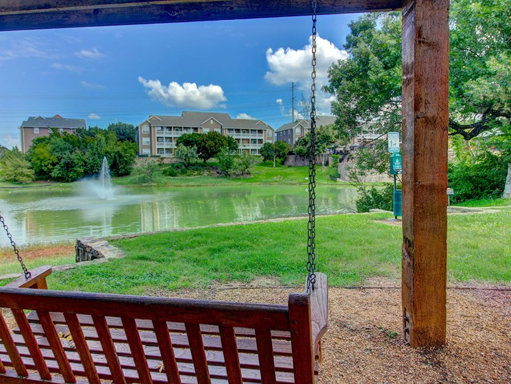 Sundeck with Swings Overlooking Resort Style Pool and Pond