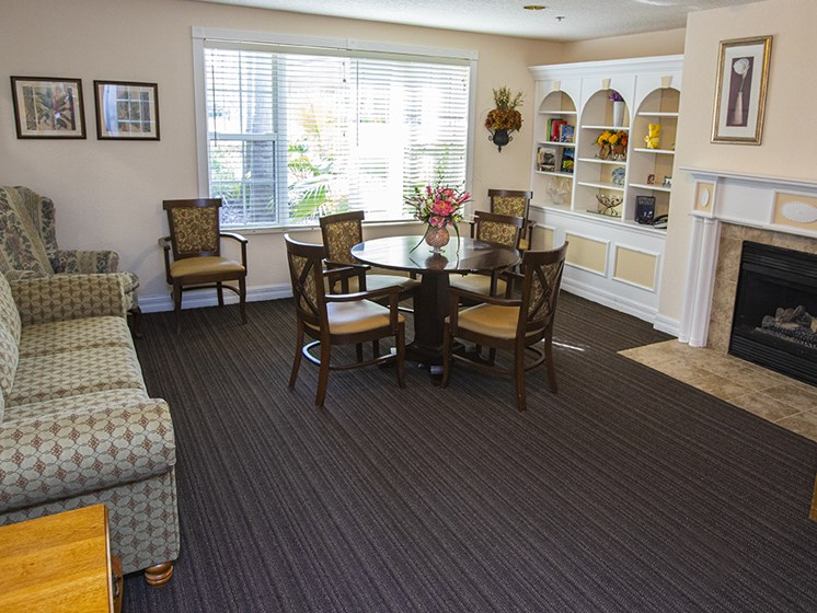 Lounge Area With Fireplace at Savannah Court & Cottage of Oviedo, Oviedo, FL, 32765