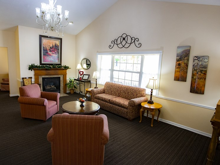 Lounge Area With Fireplace at Savannah Court & Cottage of Oviedo, Florida, 32765