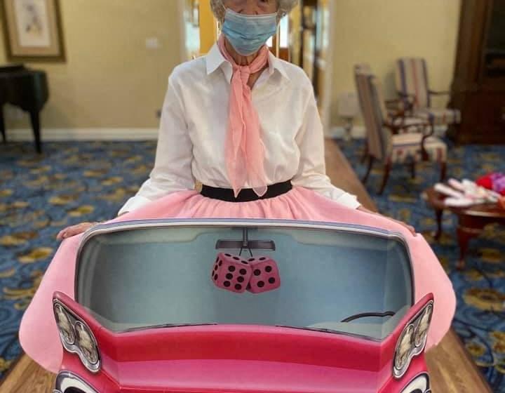 Senior Posing With Dummy Car Poster at Savannah Court of Camilla, Camilla, GA