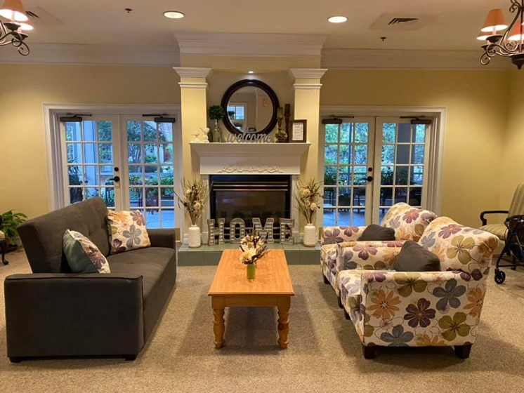 Posh Lounge Area With Fireplace In Clubhouse at Savannah Court of Lake Wales, Florida