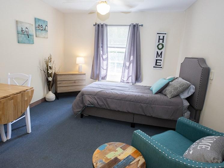 Bedroom With Expansive Windows at Savannah Court of Lake Wales, Lake Wales, FL, 33853