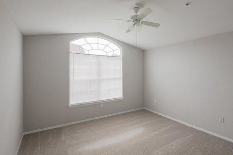 Vacant apartment home living room and ceiling fan