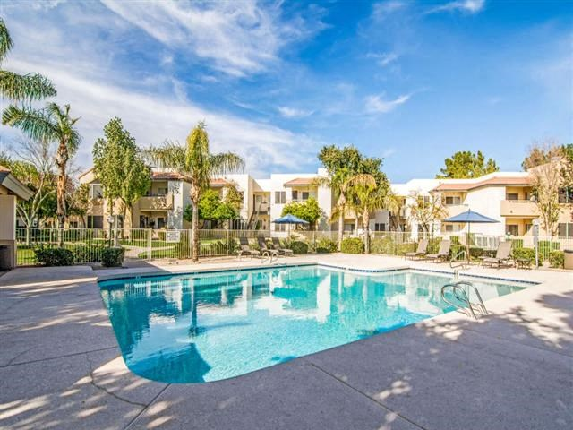 Apartments for Rent Phoenix - Village at Lakewood Sparkling Pool with Lounge Chairs