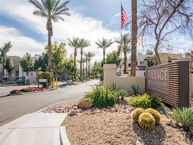 Apartments for Rent in Phoenix, AZ - Village at Lakewood Front Sign with Greenery and Gated-Access