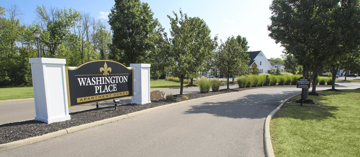This is a photo of the entrance sign at Place Apartments in Washington Township, OH