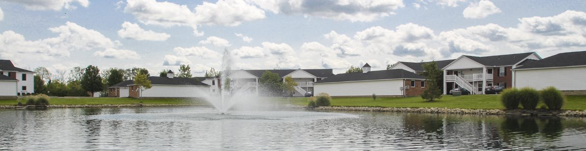 This is a photo of a fountain in a pond at Washington Place Apartments in Washington Township, OH
