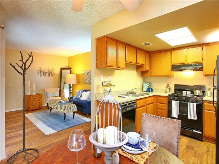 Model apartment home partial living room and kitchen area