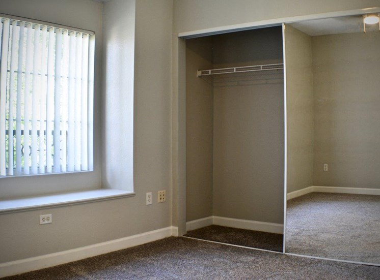 Vacant apartment home bedroom and closet