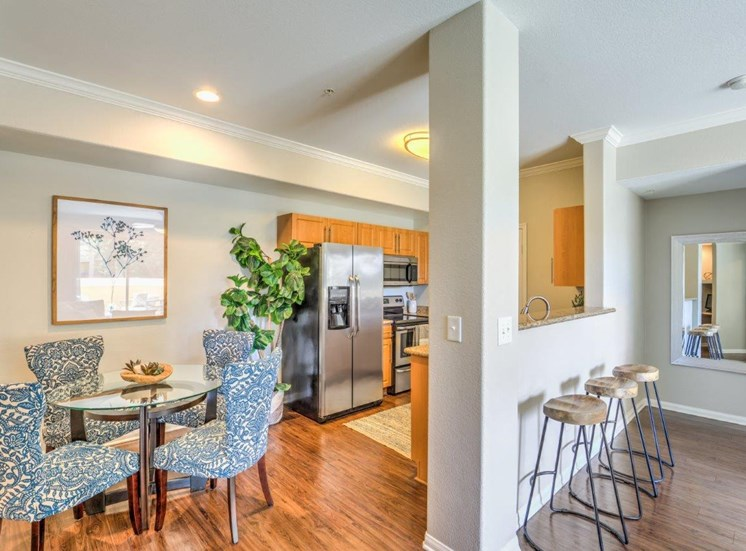 Riverside Apartments for Rent - Stone Canyon Apartments Kitchen with Attached Dining Area and Eat-in Bar with Barstools