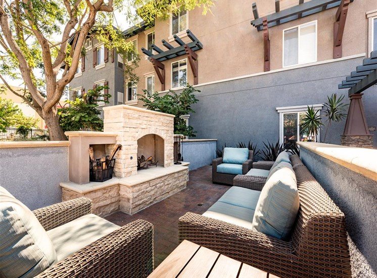 Comfortable Seating by Outdoor Fireplace at Pacifica Senior Living Oxnard, CA 93036