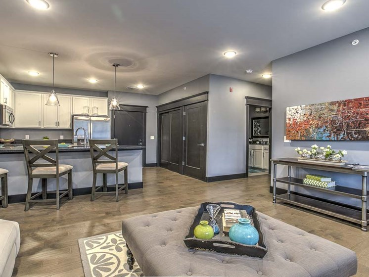 Complete view of furnished living room and kitchen spaces at The Helen
