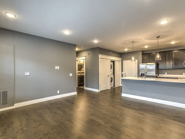 Open floorplan living room and kitchen space at The Helen