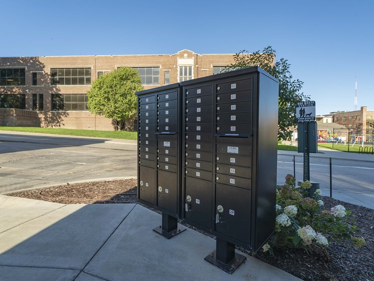 Unit of a group of resident mailboxes outside of The Helen apartments in Omaha