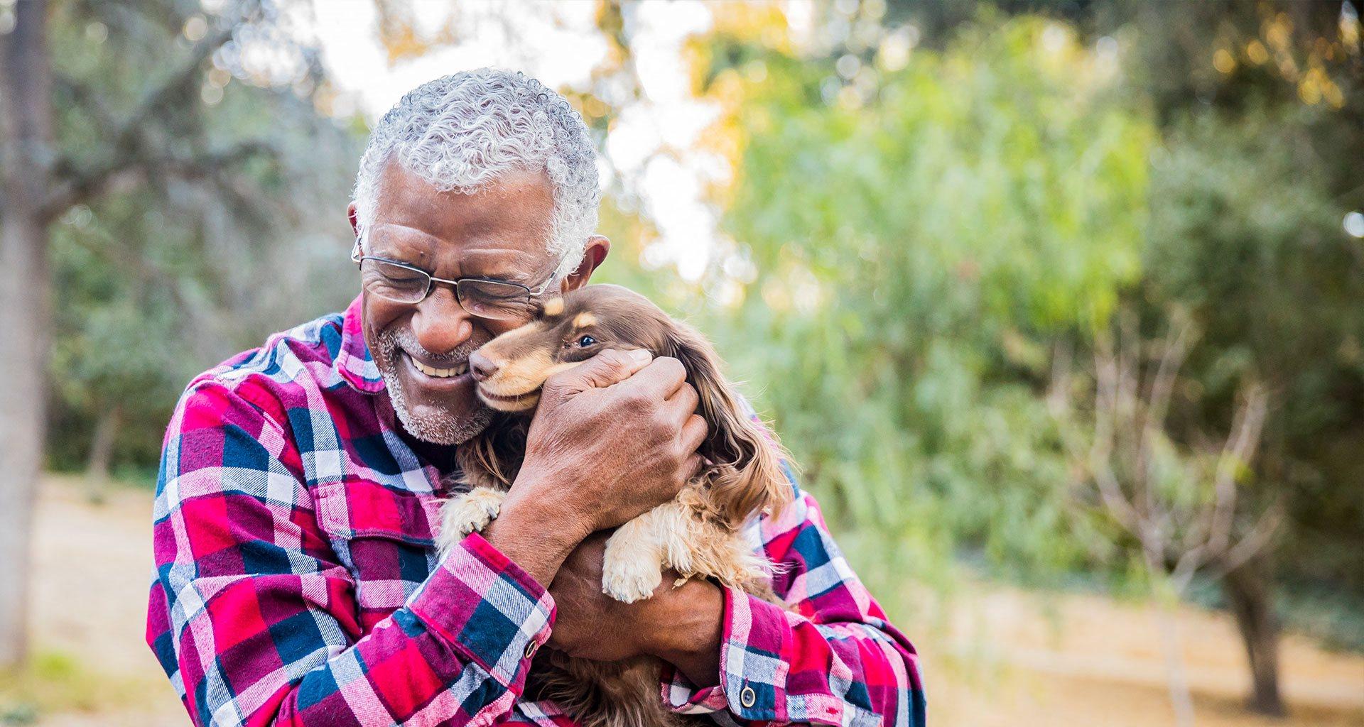 Senior Loving His Pet at Pacifica Senior Living Vista, Vista, CA