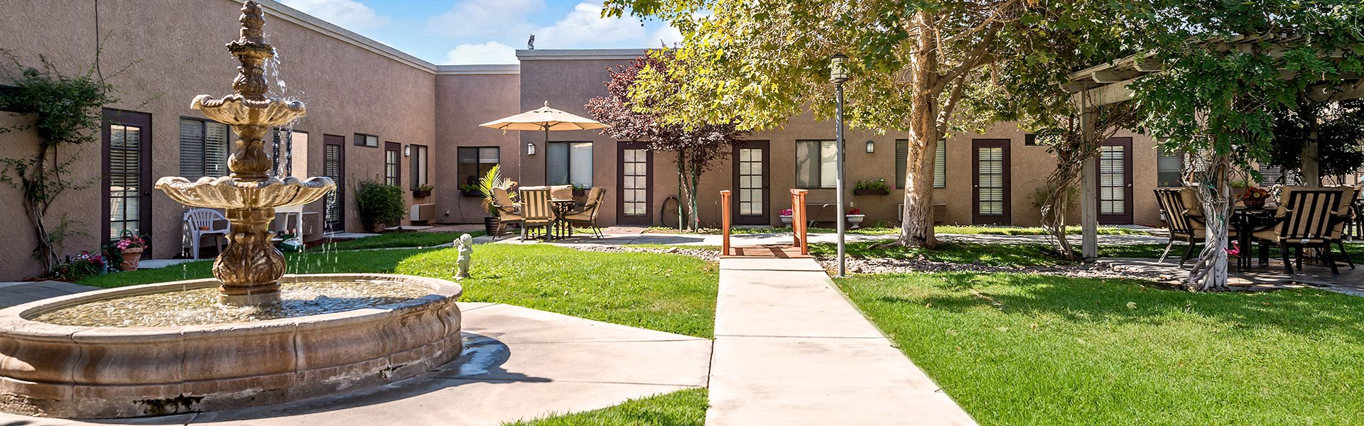 Beautifully landscaped grounds with mountain views at Sierra Vista Independent & Assisted Living, Victorville
