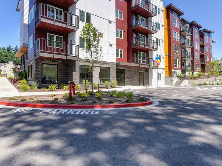 Apartment Exterior with Road, No Parking Zone, and Trees
