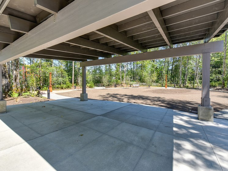 Outside Rest Area with Concrete Floor and Structure for Shade, Soil and Trees