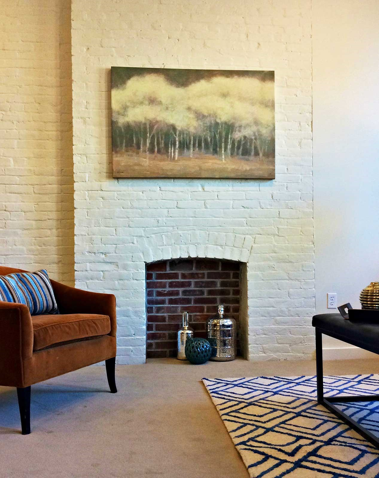 Brick interior with inset detail to mimic a fireplace.