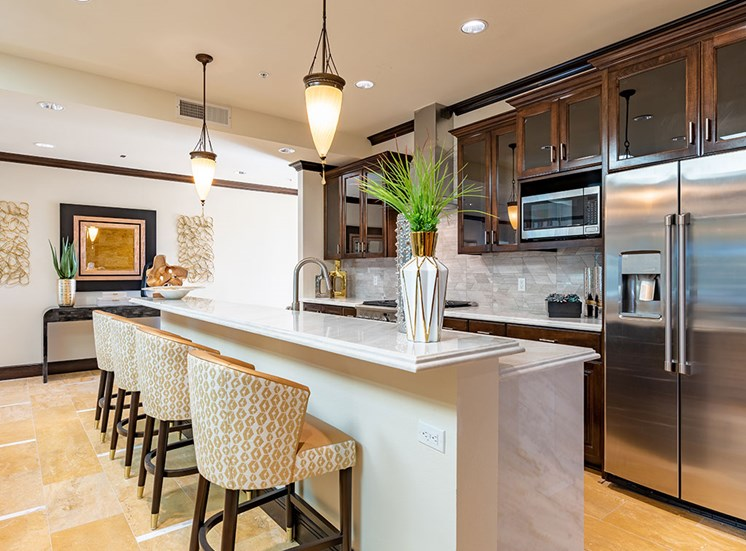 Fitted Kitchen With Island Dining at Hollywood Hills, A Pacifica Senior Living Community, Los Angeles