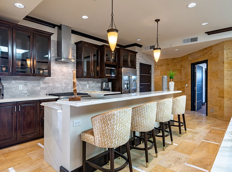 European-Style Kitchen With Breakfast Bar at Hollywood Hills, A Pacifica Senior Living Community, California