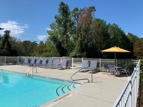Sparkling swimming pool at Deerbrook Apartments in Wilmington, NC 28405